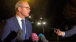 Coveney speaks to the media at Stormont. Photo credit: David Young/PA Wire