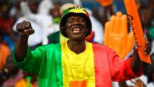 That's handy: A Mali fan does his motorbike impression and gets a big hand for his efforts