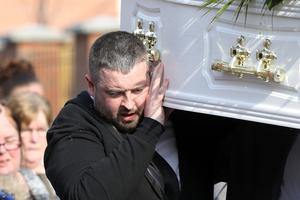 Kerry Lee's brother Chrisy carries his sisters coffin. Credit: Declan Roughan