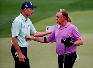 LOUISVILLE, KY - AUGUST 08: (L-R) Jim Furyk of the United States and Miguel Angel Jimenez of Spain shake hands on the 18th green during the second round of the 96th PGA Championship at Valhalla Golf Club on August 8, 2014 in Louisville, Kentucky.  (Photo by Sam Greenwood/Getty Images)
