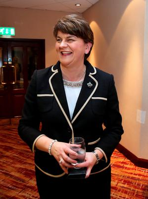 Arlene Foster, Northern Ireland Finance Minister smiles at a hotel in Belfast before being elected leader of the Democratic Unionist Party (DUP) on December 17, 2015. A special electoral college will gather at the hotel, and Foster is the only candidate for the leadership. Foster will replace Peter Robinson following his announcement that he will step down as Northern Ireland's First Minister and as leader of the DUP.  AFP PHOTO / PAUL FAITHPAUL FAITH/AFP/Getty Images