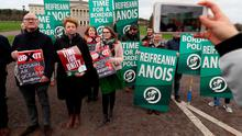 Sinn Fein activists calling for a border poll, stage a demonstration outside Parliament Buildings, Stormont, Belfast, Picture date: Friday January 31, 2020.