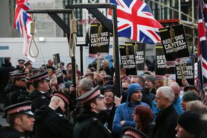 Protesters, many from far-right political organisations, demonstrate outside the Old Bailey before the sentencing of Michael Adebolajo and Michael Adebowale on February 26, 2014 in London, England. Mr Adebolajo and Mr Adebowale have been convicted of murdering Fusilier Lee Rigby as he walked back to Woolwich Barracks in south-east London on May 22, 2013.  (Photo by Oli Scarff/Getty Images)
