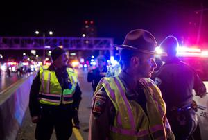 MINNEAPOLIS, MN - NOVEMBER 10: Police block protesters of President-elect Donald Trump from marching after they blocked traffic on I-94 on November 10, 2016 in Minneapolis, Minnesota. Thousands of people across the country have taken to the streets in protest in the days following the election of Republican Donald Trump over Democrat Hillary Clinton. (Photo by Stephen Maturen/Getty Images)