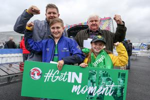 Press Eye - Northern Ireland - 16th June 2016  Fans gather in the Northern Ireland fan zone in association with Vauxhall at Titanic slipways, as Northern Ireland meet Ukraine in the Euros on June 16th.  Pictured: Fans who won a spot prize of VIP upgrade are, Granda Anderson, Ian Anderson, Luke and Katie Anderson.  Picture: Philip Magowan / PressEye