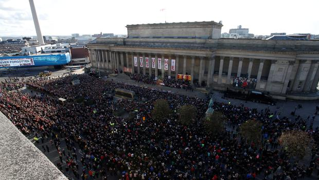 Members of the public attend a commemorative event at St George's Hall in Liverpool, to mark the outcome of the Hillsborough inquest which ruled that 96 Liverpool fans who died as a result of the Hillsborough disaster were unlawfully killed. PA