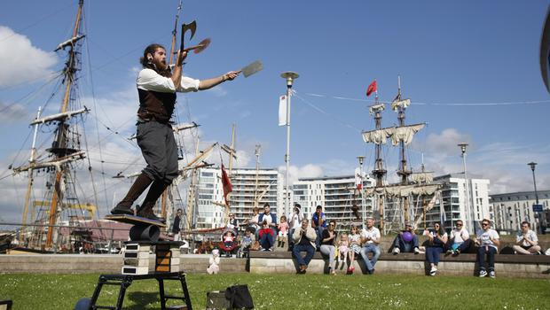 A Circus artist entratains people during the  Maritime festival in Belfast. Pic by Peter Morrison