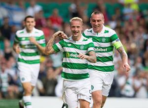 Celtic's Leigh Griffiths celebrates scoring his side's third goal of the game with teammate Scott Brown during the UEFA Champions League qualifying play-off, first leg match at Celtic Park, Glasgow. PRESS ASSOCIATION Photo. Picture date: Wednesday August 17, 2016. See PA story SOCCER Celtic. Photo credit should read: Jeff Holmes/PA Wire