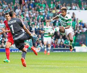 Celtic's Scott Sinclair (right) has a shot on goal ahead of Hapoel Be'er Sheva goalkeeper David Goresh (right) during the UEFA Champions League qualifying play-off, first leg match at Celtic Park, Glasgow. PRESS ASSOCIATION Photo. Picture date: Wednesday August 17, 2016. See PA story SOCCER Celtic. Photo credit should read: Jeff Holmes/PA Wire