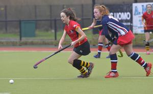 Mandatory Credit: Rowland White / PressEye Belfast Telegraph Schools' Cup Semi-Final Teams: Banbridge Academy (red) v Ballyclare High School (blue) Venue: Lisnagarvey Date: 11th February 2015 Caption: Katie McKee, Banbridge and Zoe Wilson, Ballyclare