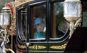 Queen Elizabeth II and the President of Ireland, Michael D Higgins arrive in a state carriage at Windsor Castle, Berkshire during the first State visit to the UK by an Irish President