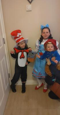 Eva is age 8 and is dressed as Dorothy from the Wizard of Oz. Mya is age 5 and is dressed as the Cat in the Hat. Coen is 9 months and is dressed as Paddington Bear. From Mallusk, Newtownabbey.