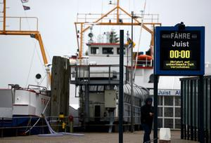 "NORDDEICH, GERMANY - DECEMBER 05:  A ferryboat to the island of Juist remains in the harbour because of a severe weather warning for the North Sea coastline on December 5, 2013 near Norddeich, Germany. Germany is bracing for ""Xaver"", a heavy storm meteorologists are predicting could be the most severe storm for the region in decades.  (Photo by David Hecker/Getty Images)"