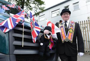 Pacemaker Press 12-07-2019:   Twelfth of July parades are taking place in 18 locations across Northern Ireland. Tens of thousands of people are expected at the marches, which mark the anniversary of the Battle of the Boyne. The day's longest parade, in Belfast, stretches to six miles (9.5km) - nine districts will take part, accompanied by about 60 bands. As part of it, a wreath-laying ceremony took place at the Cenotaph at Belfast City Hall. Ronnie Thompson LOL 1977 who is celebrating his 72 birthday today pictured at the Belfast parade. Picture By: Arthur Allison/Pacemaker Press.