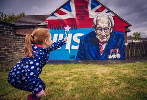 Hannah Patterson (5) grants Capt. Tom Moore a birthday wish with her homemade wand at the new mural in Clonduff, east Belfast on April 29th 2020 (Photo by Kevin Scott for Belfast Telegraph)