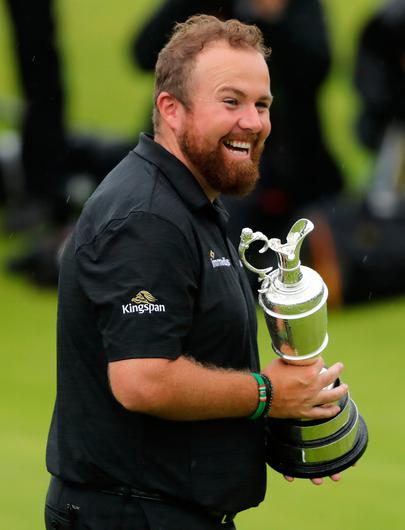 Republic of Ireland's Shane Lowry celebrates with Claret Jug after winning The Open Championship 2019 at Royal Portrush Golf Club. PRESS ASSOCIATION Photo. Picture date: Sunday July 21, 2019. See PA story GOLF Open. Photo credit should read: Niall Carson/PA Wire. RESTRICTIONS: Editorial use only. No commercial use. Still image use only. The Open Championship logo and clear link to The Open website (TheOpen.com) to be included on website publishing.