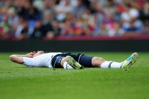 LONDON, ENGLAND - AUGUST 18:  Gylfi Sigurdsson of Tottenham Hotspur lies on the pitch during the Barclays Premier League match between Crystal Palace and Tottenham Hotspur at Selhurst Park on Augsut 18, 2013 in London, England.  (Photo by Jamie McDonald/Getty Images)