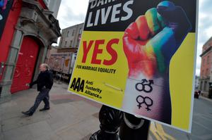 A man walks past billboard posters promoting the Yes campaign in favour of same-sex marriage on May 22, 2015 in Dublin, Ireland. (Photo by Charles McQuillan/Getty Images)