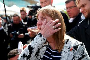 WARRINGTON, ENGLAND - APRIL 26:  Margaret Aspinall of the Hillsborough Family Support Group  ahows her emotion as she departs Birchwood Park after hearing the conclusions of the Hillsborough inquest on April 26, 2016 in Warrington, England. The fresh inquests into the 1989 Hillsborough disaster, in which 96 football supporters were crushed to death, concluded on April 26, 2016 with a verdict of unlawful killing, after the initial verdicts were quashed. Relatives of Liverpool supporters who died in Britain's worst sporting disaster gathered in the purpose-built court to hear the jury's verdict in Warrington after a 25 year fight to overturn the accidental death verdicts handed down at the initial 1991 inquiry.  (Photo by Christopher Furlong/Getty Images)