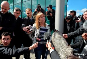 Margaret Aspinall (C), whose son James died in the 1989 Hillsborough disaster, pauses as she makes a statement following the conclusion of the inquest into the 1989 Hillsborough disaster, at the coroner's court in Warrington, north-west England on April 26, 2016. The 96 Liverpool fans who died in Britain's 1989 Hillsborough football stadium disaster were unlawfully killed, a jury found Tuesday following the longest-running inquest in English legal history. After hearing more than two years of evidence, the jury also concluded that the behaviour of Liverpool supporters on the day did not cause or contribute to Britain's worst sports stadium tragedy.  / AFP PHOTO / PAUL ELLISPAUL ELLIS/AFP/Getty Images
