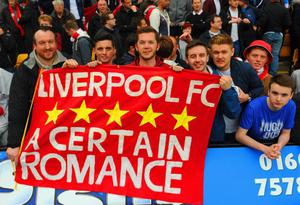 NORWICH, ENGLAND - APRIL 20:  Liverpool fans show their support during the Barclays Premier League match between Norwich City and Liverpool at Carrow Road on April 20, 2014 in Norwich, England.  (Photo by Michael Regan/Getty Images)