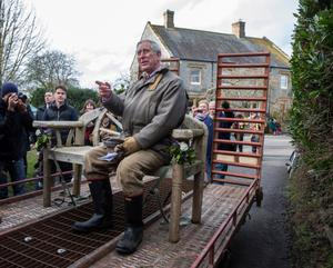 GETTY IMAGES ROYAL PHOTOGRAPHER OF THE YEAR FINALIST  The Prince of Wales arrives to meet the flood-hit community of Muchleney on the Somerset levels. Picture: David Hartley