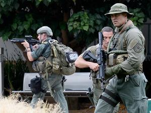SANTA MONICA, CA - JUNE 07:  Los Angeles County SWAT team members search the grounds of Santa Monica College near the library after multiple shootings  were reported on the campus June 7, 2013 in Santa Monica, California.  According to reports, at least three people have been injured, and a suspect was taken into custody. (Photo by Kevork Djansezian/Getty Images)