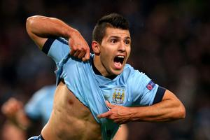 Sergio Aguero of Manchester City celebrates after scoring his team's third and match-winning goal during the UEFA Champions League Group E match  (Photo by Alex Livesey/Getty Images)