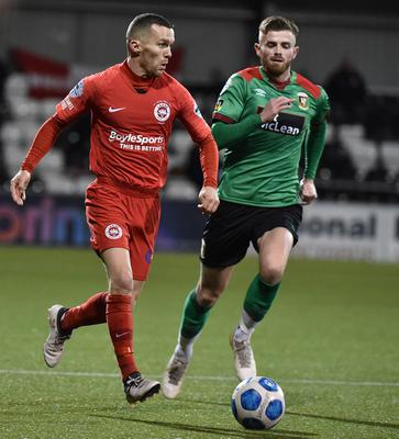 PACEMAKER PRESS  BELFAST 02/12/2020 Glentoran v Larne ToalsBet.Com Co Antrim Shield Final.  Glentoran's Ruaidhri Donnelly  and Larne's Martin Donnelly  during this evening's game at Seaview  in Belfast. Pic Colm Lenaghan/Pacemaker