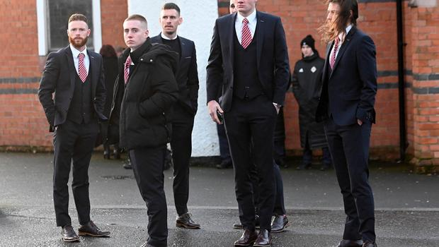 Pacemaker Press 14/12/19 Larne Platers attend The Funeral of Irish League Footballer Jerry Thompson at Sacred Heart Church  in Belfast. The north Belfast man passed away suddenly on Tuesday. A popular figure in local football, Jerry also played for Portadown, Larne, Donegal Celtic and Clifonville Olympic. Pic Colm Lenaghan/Pacemaker