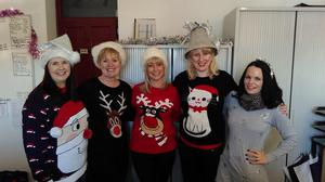 Bangor visitor information centre donning their favourite festive jumpers