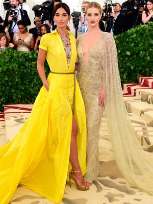 Lily Aldridge (left) and Rosie Huntington-Whiteley attending the Metropolitan Museum of Art Costume Institute Benefit Gala 2018 in New York, USA. PRESS ASSOCIATION Photo. Picture date: Picture date: Monday May 7, 2018. See PA story SHOWBIZ MET Gala. Photo credit should read: Ian West/PA Wire