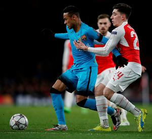 Barcelona's Brazilian forward Neymar (L) vies with Arsenal's Spanish defender Hector Bellerin during the UEFA Champions League round of 16 1st leg football match between Arsenal and Barcelona at the Emirates Stadium in London on February 23, 2016.   / AFP / ADRIAN DENNISADRIAN DENNIS/AFP/Getty Images