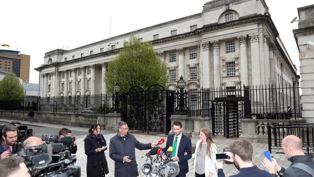 Daniel Mcarthur and his wife Amy face media outside the court (Brian Lawless/PA)