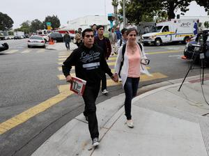 SANTA MONICA, CA - JUNE 07:  Students at Santa Monica College holding hands are released from the campus after they were locked down following multiple shootings reported on the campus June 7, 2013 in Santa Monica, California. Six people were killed in the rampage, according to news reports. (Photo by Kevork Djansezian/Getty Images)