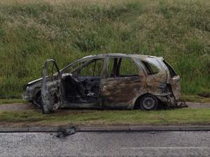 A burnt car sits on the O'Neill Road in the Carnmoney Area. NO-BYLINE Liam McBurney