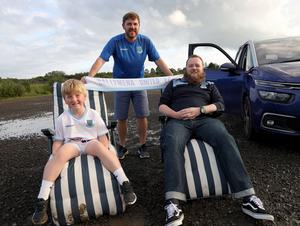 PACEMAKER PRESS BELFAST 31/7/2020 Ballymena United suppporters gathered at a drive-in screening of the match against Glentoran at Ballymena Showgrounds in order to facilitate social distancing.  Pictured Harry and Simon Finlay with Paul Jeffries. Photo Pacemaker Press