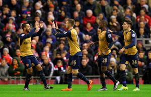 LIVERPOOL, ENGLAND - JANUARY 13:  Aaron Ramsey (2nd L) of Arsenal celebrates scoring his team's first goal with his team mates Theo Walcott (1st L), Joel Campbell (2nd R) and Hector Bellerin (1st R) during the Barclays Premier League match between Liverpool and Arsenal at Anfield on January 13, 2016 in Liverpool, England.  (Photo by Alex Livesey/Getty Images)