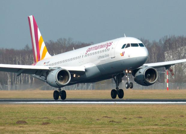 The March 7, 2014 photo shows an Airbus A320 of German airline Germanwings as it lands at the airport in Hamburg, northern Germany. A Germanwings passenger jet carrying 148 people crashed in the French Alps region as it traveled from Barcelona to Duesseldorf Tuesday, March 24, 2015.  (AP Photo/dpa, Jan-Arwed Richter)