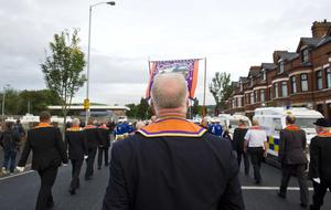 "Pacemaker press 01/10/2016 The Ligoniel Lodges have held a permanent protest since July 2013 over a decision to stop their return parade past the Ardoyne shops. They have agreed to a voluntary moratorium on future return parades. The Twaddell protest camp on the interface will be dismantled following the parade Around 600 police officers are on duty in the area.  Several dozen protesters from the Greater Ardoyne Residents Collective (Garc) gathered at the Ardoyne shops as the parade got underway. They chanted ""walk of shame"" as the parade passed the Ardoyne shops but dispersed peacefully after the march passed. Pictured are Loyalist band members being welcomed home by their supporters.  Picture Mark Marlow/pacemaker press"