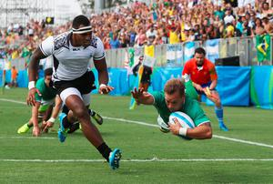 RIO DE JANEIRO, BRAZIL - AUGUST 09:  Felipe Claro of Brazil scores a try during the Men's Rugby Sevens Pool A match between Fiji and Brazil on Day 4 of the Rio 2016 Olympic Games at Deodoro Stadium on August 9, 2016 in Rio de Janeiro, Brazil.  (Photo by David Rogers/Getty Images)