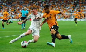 BJ Burns tackles Wolves' Jonny at Molineux last summer in the Europa League.