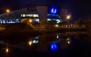 The O on the south side of Autzen Stadium in Eugene, Ore. reflects in a nearby stream as it shines blue Friday April 1, 2016, in recognition of World Autism Awareness Day 2016 on April 2. A local non-profit Bridgeway House that offers treatments, developmental therapies, enrichment courses, and support to children and families affected by autism, commissioned the special lighting as part of their annual fundraising event to be held at the stadium Saturday evening. This year marks the eight year that organisations have celebrated World Autism Awareness April 2 by lighting landmarks around the world, but the first year for a Eugene landmark. (Chris Pietsch/The Register-Guard via AP)
