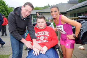 Belfast Telegraph Runher - Seapark to Crawfordsburn - 23rd May 2014 Presseye / Declan Roughan  (L-R) David Kerr with son Aaron and Cathy Mc Court