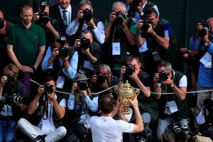 Britain's Andy Murray poses with the winner's trophy after his men's singles final victory over Canada's Milos Raonic on the last day of the 2016 Wimbledon Championships at The All England Lawn Tennis Club in Wimbledon, southwest London, on July 10, 2016. / AFP PHOTO / POOL AND AFP PHOTO / John WALTON / RESTRICTED TO EDITORIAL USEJOHN WALTON/AFP/Getty Images