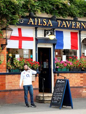 An England fan waits outside a pub in Twickenham before the Rugby World Cup match at Twickenham Stadium, London.
