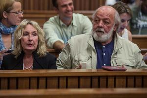 June, left, and Barry Steenkamp, parents of the late Reeva Steenkamp, attend court on the third day of mitigation of sentencing for Oscar Pistorius at the high court in Pretoria, South Africa, Wednesday, Oct. 15, 2014.