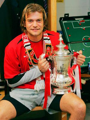 Roy Carroll with the trophy