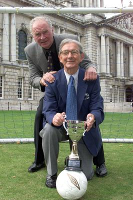 Attending the launch of the Northern Ireland Boys Football Association and Belfast City Council  Mallusk Football Festival were Harry Gregg and Bertie Peacock who helped make the draw for opposing teams in the opening rounds. Picture By Rick Hewitt. 26/8/03.