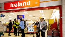 Older shoppers enter the branch of Iceland at the Kennedy Centre, Belfast (Liam McBurney/PA)
